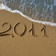 Stock Photo: 2011 - The inscription on the sand