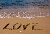 Love - the inscription on the sand — Stock Photo
