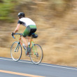 Man cyclist racing past — Stock Photo