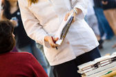 Woman with clipboard — Stock Photo