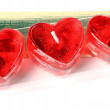 Row of red heart candles — Stock Photo