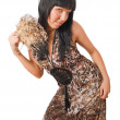Young female with fur fan in long dress — Stok fotoğraf