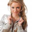 Stock Photo: Beautiful young female in silver jacket looking