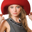 Beautiful young female in red hat — Stock Photo