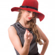 Pretty girl in big red hat wave to you isolated — Stock Photo