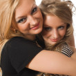 Royalty-Free Stock Photo: Embracing similar sisters