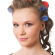 Royalty-Free Stock Photo: Portrait of young female with hairrollers isolat