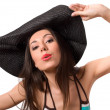 Royalty-Free Stock Photo: Kissing brunette in big hat