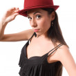 Stock Photo: Brunette female in red hat isolated