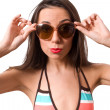 Female in big sunglasses isolated — Stock Photo