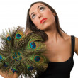 Stock Photo: Pretty brunette with peacock hand fisolated