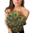 Slim female with peacock hand fan isolated — Stock Photo