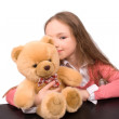 Little girl with teddy bear isolated - Stock Photo