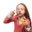 Little girl blow bubbles isolated — Stock Photo