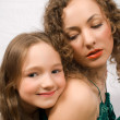 Happy little girl with her mother — Stock Photo