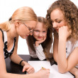 Two mams teach little girl isolated — Stock Photo