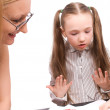 Little schoolgirl speak with teacher isolated — Stock Photo