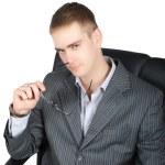 Portrait of doubting busisnessman isolated — Stock Photo #1339630