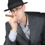Portrait of retro busisnessman smoking cigar is — Stock Photo #1339633