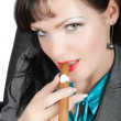 Closeup portrait of sexy brunette smoking cigar — Stock Photo