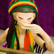 Smoking alien as rastafari — Stock Photo