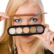 Stock Photo: Blonde with makeup brushes isolated