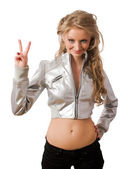 Slim young blonde in silver jacket show victory — Stock Photo