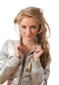 Beautiful young female in silver jacket looking — Stock Photo