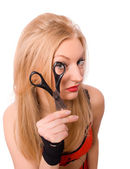 Pretty blonde looking though scissors isolated — Stock Photo
