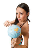Nude young female pointing at globe isolated — Stock Photo