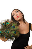 Pretty brunette with peacock hand fan isolated — Stock Photo