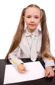 Little girl writing or drawing isolated — Stock Photo