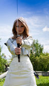 Young female with samurai sword outdoor — Stock Photo