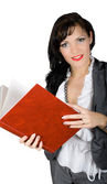 Confident busisnesswoman with big red book isola — Stock Photo