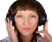 Mature female in headphones isolated — Stock Photo
