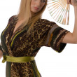Pretty blonde with a hand fan isolated — Stock Photo #1340007