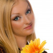 Blonde with yelllow flower isolated — Stock Photo