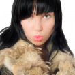 Stock Photo: Sexy young babe in fur coat isolated