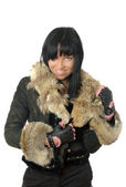 Sexy young babe in fur coat isolated — Stock Photo