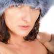 Stock Photo: Seductive mature brunette in fur cap