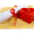 Stock Photo: Paper roll and heart candle isolated