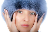 Seductive mature brunette in fur cap — Stock Photo