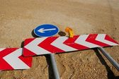 Road construction detour signs on the ground — Stock Photo