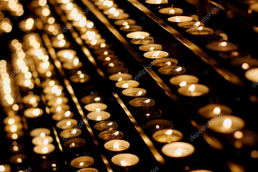 Rows of burning candles in a dim church — Stock Photo #1357643