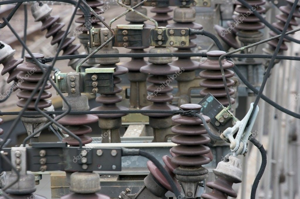 Electric substation insulators and wires — Stock Photo #1360794