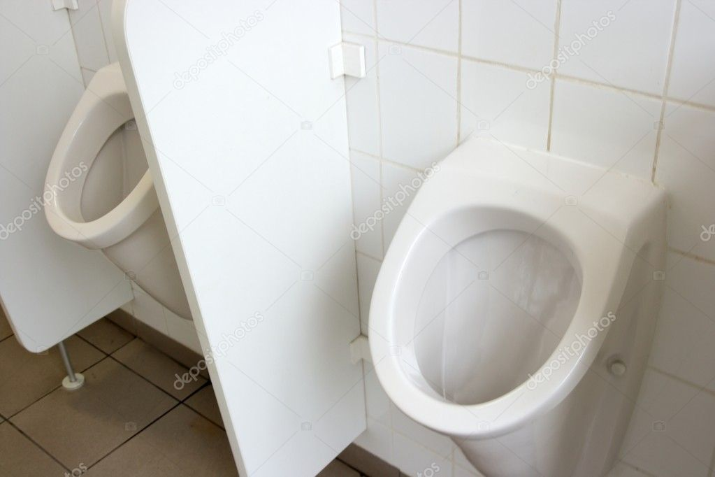 Mens toilet inside, two urinals, white wall  Stock Photo #1367373