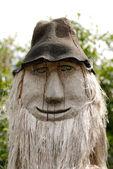 Wooodcarving figure in country — Stock Photo