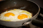 Cooking two fried eggs — Stock Photo