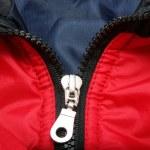Metal zipper from red coat — Stock Photo #1337597