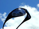 Sunglasses in sky — Stock Photo